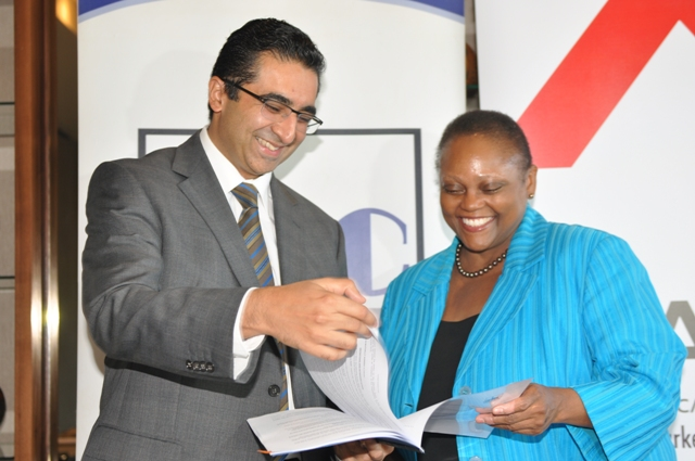 ABC Bank Group Managing Director, Shamaz Savani with EAX Board Chair Dr. Jendayi Frazer