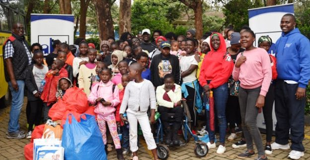 Kayole Children are presented with the early Christmas goodies